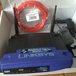 The Linksys WRT54GS v5.1 router with Gigabit WiFi, 4 100mbps ETH-ports and                                              0 USB-ports