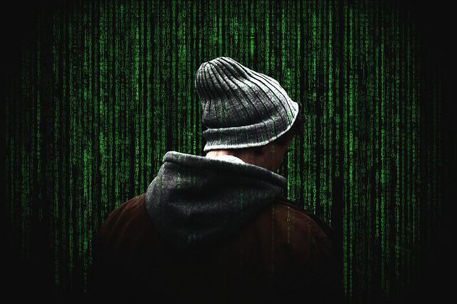 the back of a man in front of screen of encrypted data