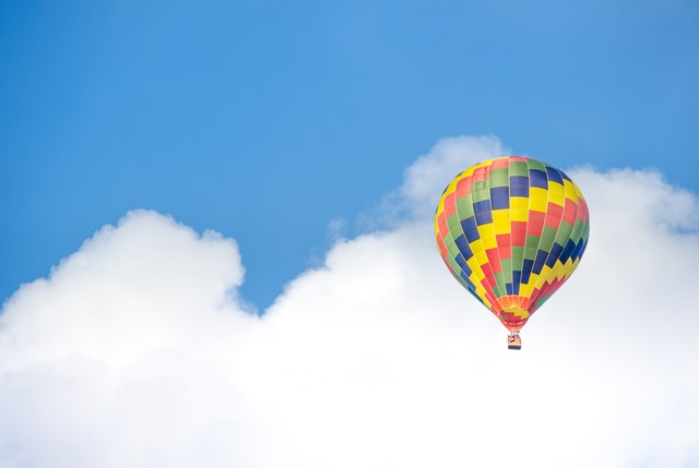 hot air balloon floating in clouds