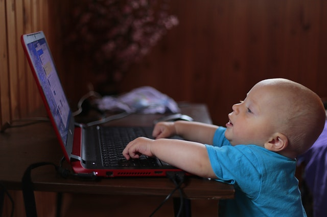 baby using a laptop