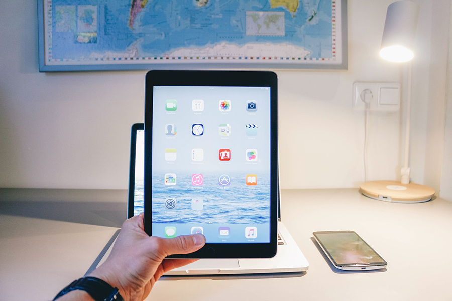 A man holding an iPad